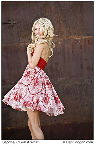 Sabrina models a cute red and white dress in front of a rusty garage door, Tucson, AZ