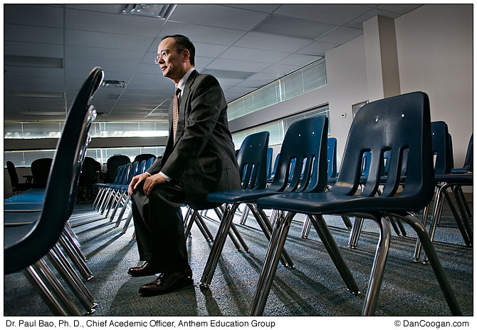 Dr. Paul Bao, Ph. D, Vice President & Chief Acedemic Officer, Anthem Education Group, sits in a room with many chairs.