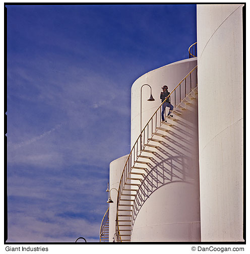 Giant Industries - Refinery Worker surveying the plant from fuel tank stairs,