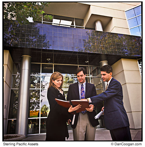 Sterling Pacific Assets, three people reviewing the Red book.